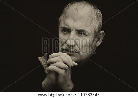 Sepia toned image of a thoughtful Caucasian man