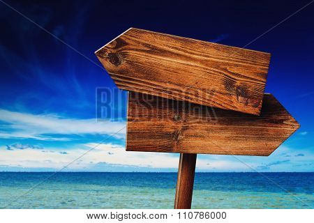 Direction Signpost on Coastal Seaside Beach Rustic Wooden Blank Sign in Tropical Summer Vacation Resort poster