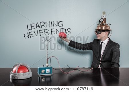 Learning never ends concept with businessman holding brain