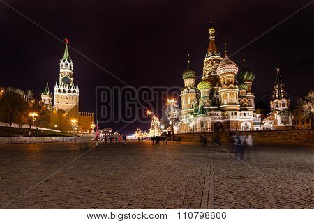 Spasskaya tower of Kremlin and cathedral on Vasilevsky Descent of Red Square in Moscow in night poster