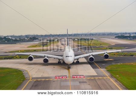 SINGAPORE - NOVEMBER 07, 2015: A380 taxiing at Changi Airport. Singapore Changi Airport, is the primary civilian airport for Singapore, and one of the largest transportation hubs in Southeast Asia