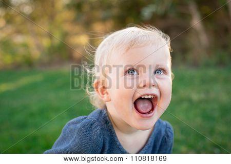 Cute expressive little girl outside