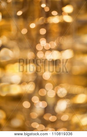 Golden, yellow bokeh background for party and sylvester
