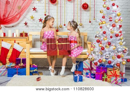 Joyful Girl Who Gave A Great Gift At Each Other In A Christmas Setting