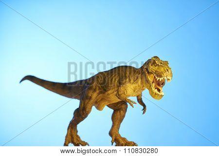 Dinosaur In Blue Background