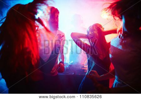 Young people dancing in nightclub