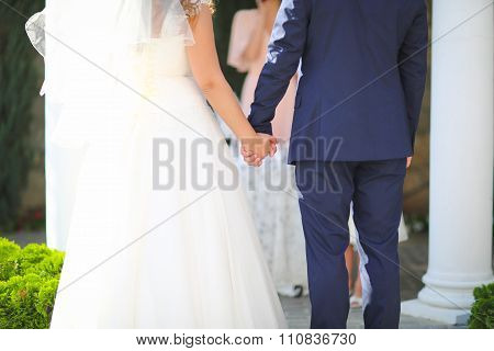 Hands Of Bride And Groom During The Oath