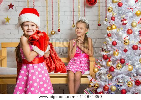 Girl Dressed As Santa Claus Brought Gifts In The Bag The Other Girl