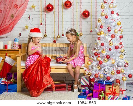 Two Girls Pulled Out A Bag Of Christmas Gifts Santa Claus
