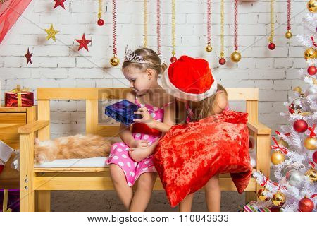 The Girl Did Not Like The Gift That Gives Her Another Girl Dressed As Santa Claus