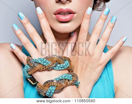 woman hands nails manicure fashion blue jewelry. Female hands with blue fingernails poster