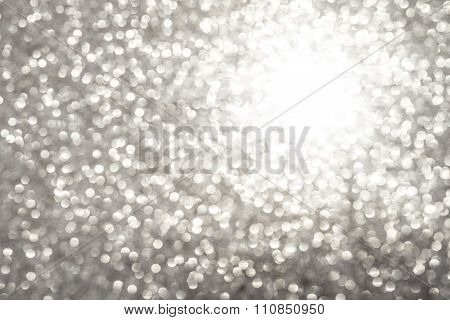 Silver White Glittering Christmas Lights. Blurred Abstract Background