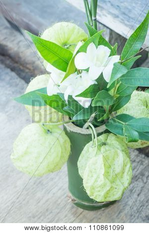 White Flower Decorated On Wooden Table