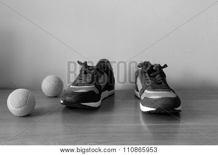 Sneakers with tennis balls
