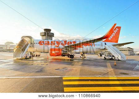 GENEVA, SWITZERLAND - NOVEMBER 18, 2015: easyJet aircraft at Geneva Airport. EasyJet is a British low-cost airline carrier, owing to its all-economy class fleet