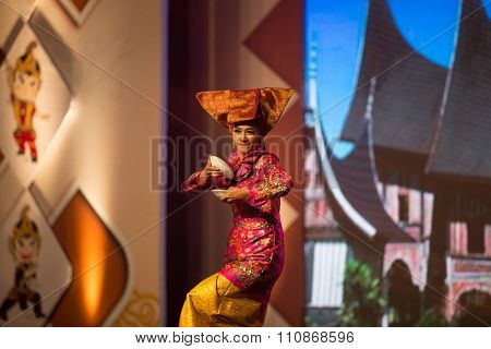 JAKARTA, INDONESIA: NOVEMBER 13, 2015: Dancers perform a traditional 'tarian pairing' from Sumatra at the opening ceremony of the 13th World Wushu Championship 2015 in Jakarta Convention Centre.
