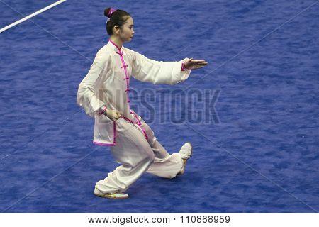 JAKARTA, INDONESIA: NOVEMBER 14, 2015: Naoko Ichikizaki from Japan performs the movements in the women's Taijiquan event at the 13th World Wushu Championship 2015 held at Istora Senayan, Jakarta.