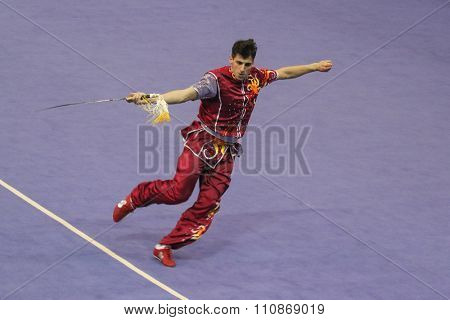 JAKARTA, INDONESIA: NOVEMBER 14, 2015: Flavio Campanile from Switzerland performs the movements in the men's Jianshu (swords) event at the 13th World Wushu Championship 2015 at Istoran Senayan.