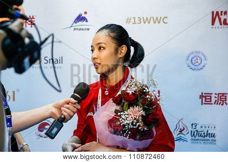JAKARTA, INDONESIA - NOVEMBER 14, 2015: Lindswell Kwok from Indonesia speaks to Wushu TV after winning the gold in the women's Taijiquan event in the 13th World Wushu Championship 2015.