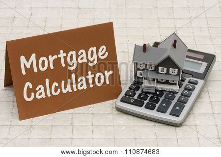 Home Mortgage Calculator, A Gray House, Brown Card And Calculator On Stone Background