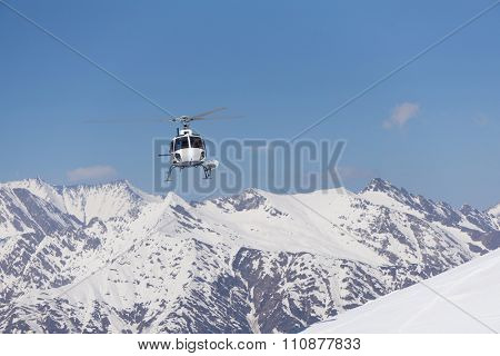 White rescue helicopter in the snowy mountains poster