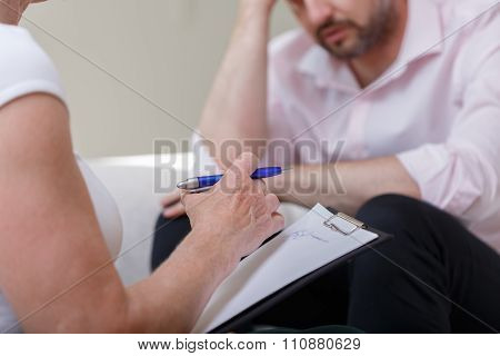 Female Counselor Helping Man