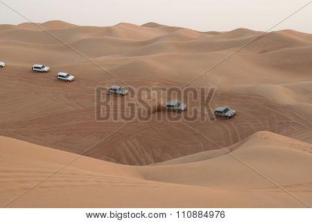 Column of crossovers travelling in sand desert