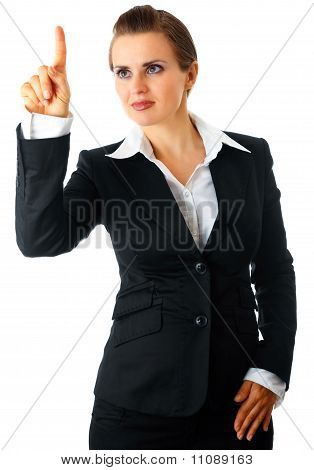 Smiling modern business woman touching abstract screen isolated on white