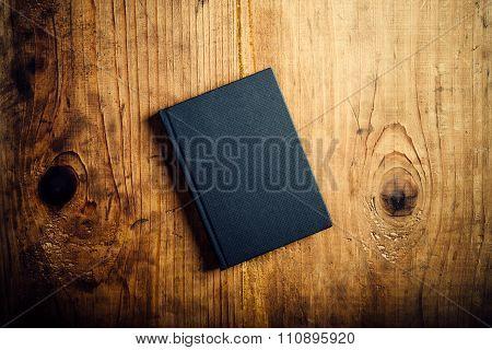 Black Notebook On Wooden Office Desk