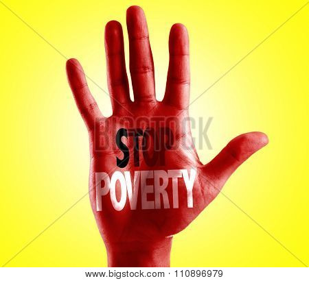 Stop Poverty written on hand with yellow background