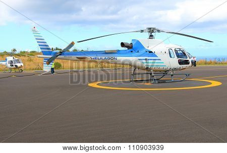 EPERON, REUNION ISLAND, FRANCE - NOVEMBER 7, 2015: The Eurocopter B3 single turbine on a Helilagon heliport. Helicopter for 6 passengers, max. weight: 2540 kg, max. speed: 278km/h