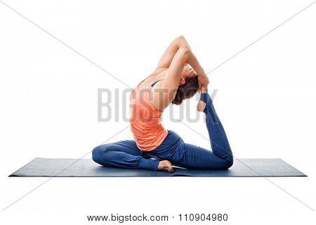 Sporty fit yogini woman doing yoga asana Eka pada kapotasana - one-legged pigeon pose isolated on white