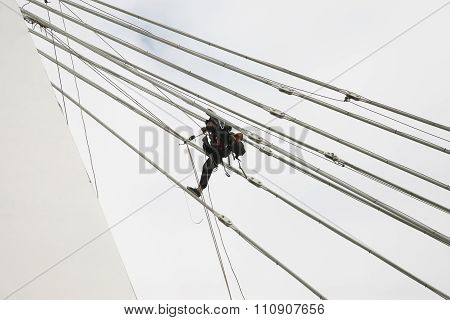 industrial climber at the altitude of assembling poster