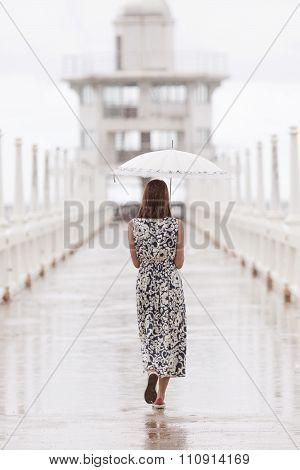 Woman And Umbrella Walking On Jett Bridge In Raining Day