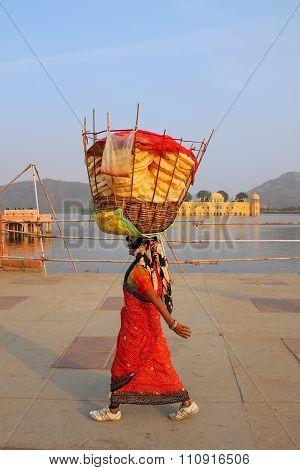 Jaipur, India - November 13: Unidentified Woman With Basket On Her Head Walks By Man Sagar Lake On N