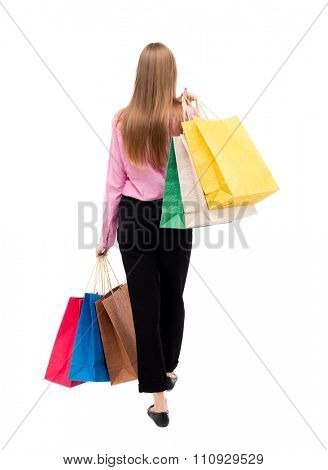 back view going  woman with shopping bags. beautiful girl in motion. backside view of person. Rear view people collection. Isolated over white. woman in pink shirt went off throwing shoulder bag