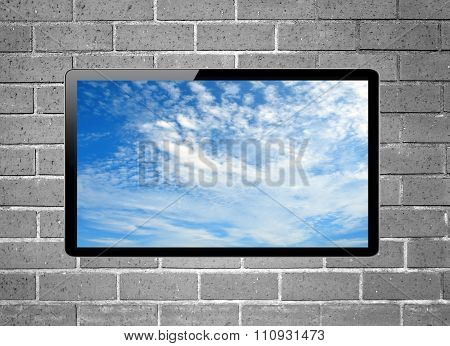 Blank Screen Lcd Tv With Blue Sky Screen Hanging On A Wall