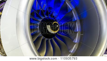 close-up of a large jet engine turbine blades poster