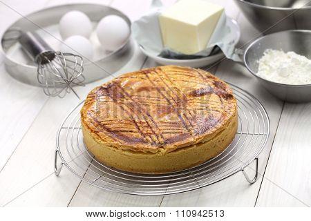 homemade gateau basque on cake cooler, freshly baked