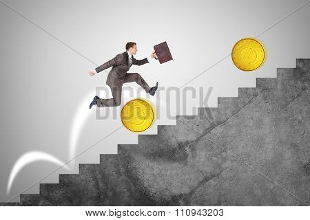 Businessman running up stairs, side view