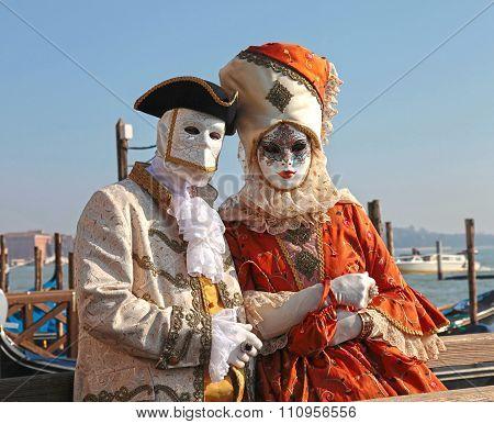 Costumed People In Venetian Mask During Venice Carnival In Venice
