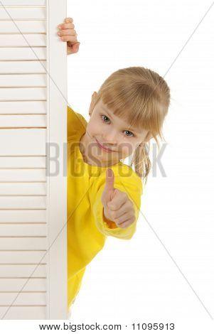 Happy girl in yellow jacket
