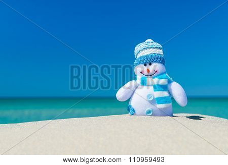 Smiley Toy Snowman In Hat And Scarf At Sea Beach.