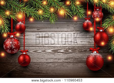 Christmas wooden background with fir branches and balls. Vector illustration.