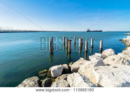 Pier And Cargo Ship In Marina Di Ravenna, Italy