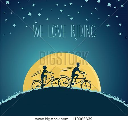 Man and woman ride bikes at night
