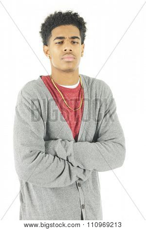 An angry, scowling older teen man.  On a white background.