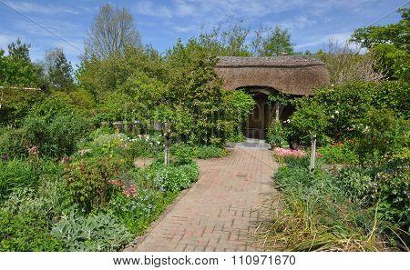 Thatched summerhouse in an English style garden. Taken near Torrington North Devon England