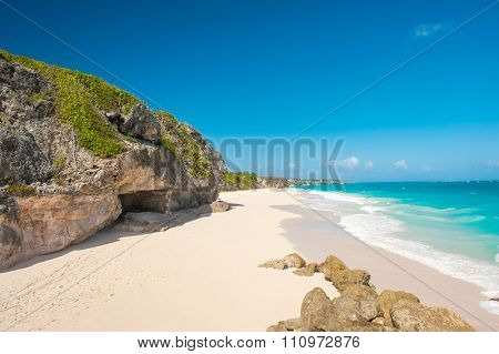 Crane Beach is one of the most beautiful beaches on the Caribbean island of Barbados. It is a tropical paradise with a white sand, turquoiuse sea and surrounding rocks