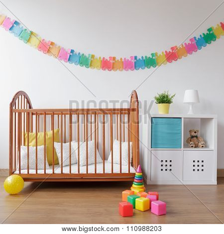 Babygirl Bedroom With Wooden Crib